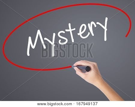 Woman Hand Writing Mystery With Black Marker On Visual Screen.