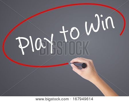 Woman Hand Writing Play To Win With Black Marker On Visual Screen