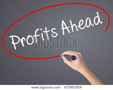 Woman Hand Writing Profits Ahead   With Black Marker On Visual Screen