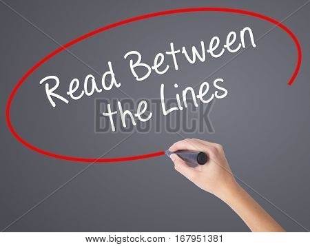 Woman Hand Writing Read Between The Lines   With Black Marker On Visual Screen