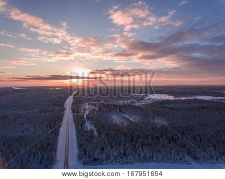 Aerial view of winter snowscape and forest