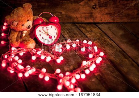 Decorations Valentine's Day. Teddy Bear and alarm clock in the shape of heart
