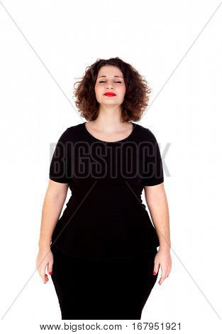 Beautiful curvy girl with black dress and red lips closing her eyes isolated on a white background