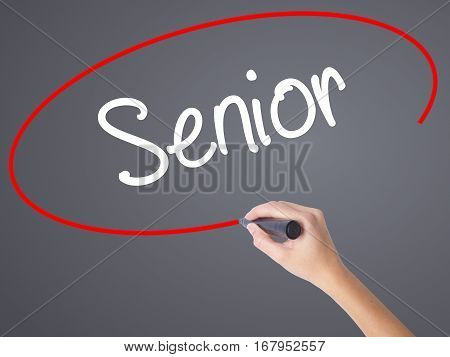 Woman Hand Writing Senior With Black Marker On Visual Screen