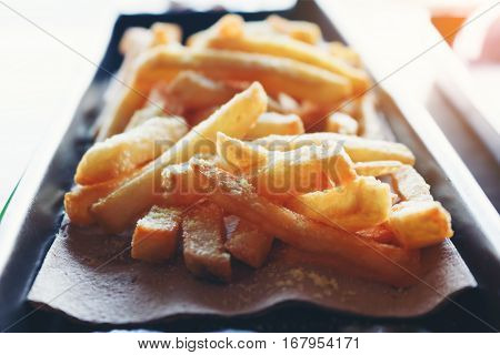 Close up fastfood with french fries junkfood on dish.