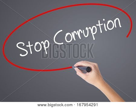 Woman Hand Writing Stop Corruption With Black Marker On Visual Screen.