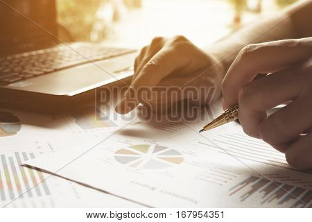 Businessman Calculate Cost And Expenses And Using Laptop For Search Data Result.