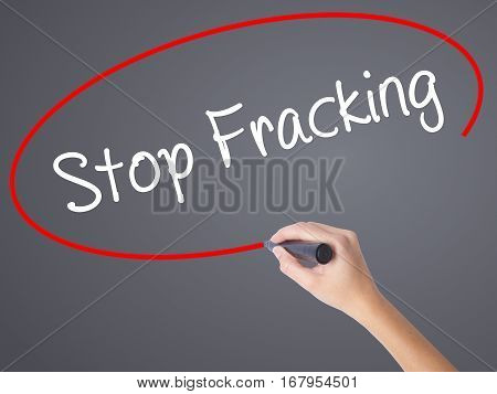 Woman Hand Writing  Stop Fracking With Black Marker On Visual Screen