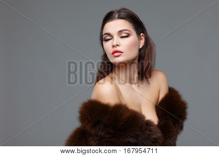 A photo of sexual beautiful girl is in fashion style is in fur clothes