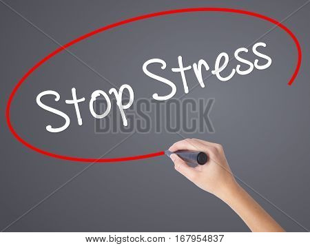Woman Hand Writing Stop Stress With Black Marker On Visual Screen