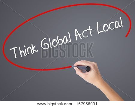 Woman Hand Writing Think Global Act Local With Black Marker On Visual Screen