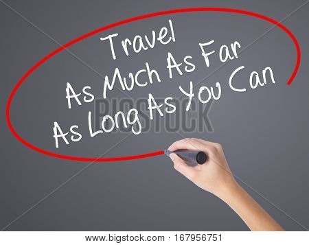 Woman Hand Writing Travel As Much As Far As Long As You Can  With Black Marker On Visual Screen