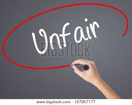 Woman Hand Writing Unfair With Black Marker On Visual Screen