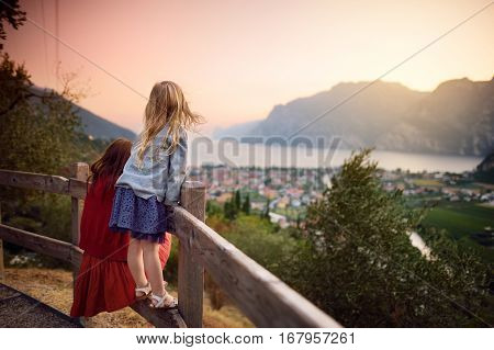 Two Little Sisters Enjoying Scenic Aerial View Of Riva Del Garda Town, Located On A Shore Of Garda L