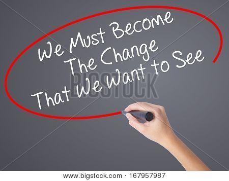 Woman Hand Writing We Must Become The Change That We Want To See With Black Marker On Visual Screen