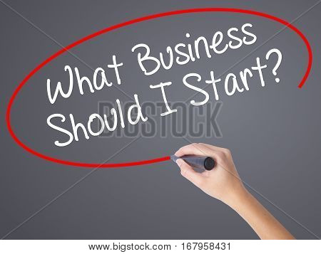 Woman Hand Writing What Business Should I Start? With Black Marker On Visual Screen