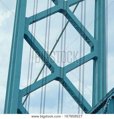 This architectural abstract details a portion of the Ambassador Bridge the suspension bridge which carries vehicular traffic across the Detroit River to and from Windsor Ontario Canada and Detroit Michigan USA.