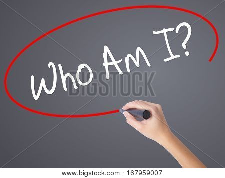 Woman Hand Writing Who Am I? With Black Marker On Visual Screen