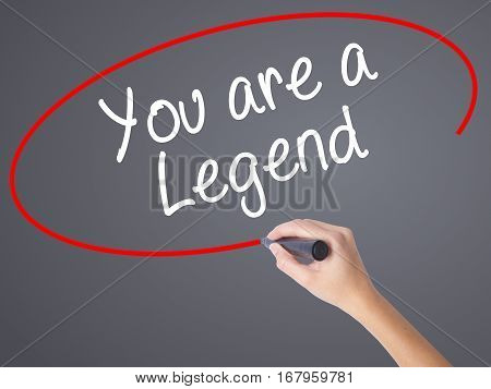 Woman Hand Writing You Are A Legend   With Black Marker On Visual Screen