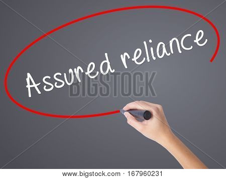 Woman Hand Writing Assured Reliance With Black Marker On Visual Screen