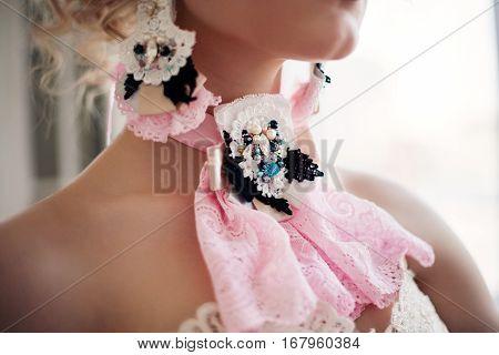 Fashion photo of beautiful girl wearing handmade accessories. Baroque style.