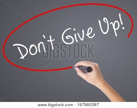 Woman Hand Writing Don't Give Up With Black Marker On Visual Screen