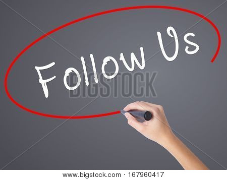 Woman Hand Writing Follow Us With Black Marker On Visual Screen