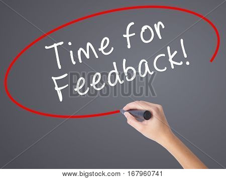 Woman Hand Writing Time For Feedback With Black Marker On Visual Screen