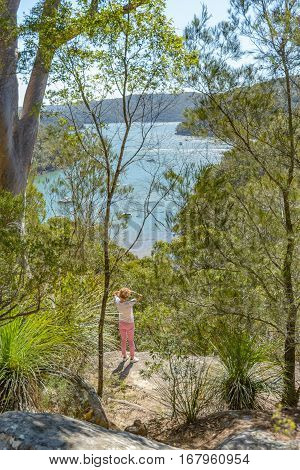 A woman at a viewpoint on the America Bay Track in the Ku-Ring-Gai Chase National Park New South Wales Australia.