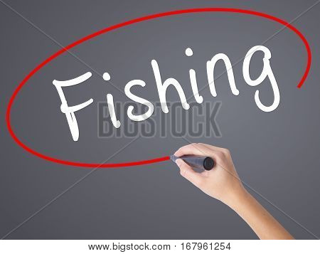 Woman Hand Writing Fishing With Black Marker On Visual Screen