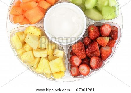 closeup fruit platter with dip on white