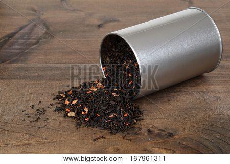 closeup spilled pumpkin and chai tea with tin