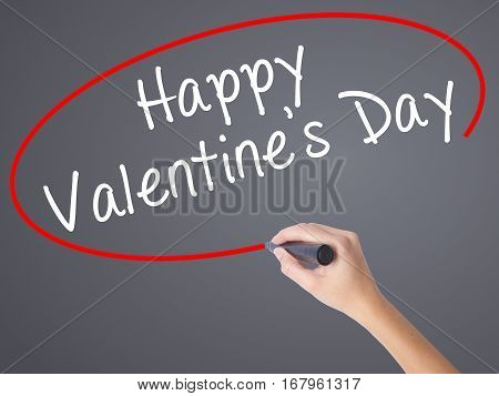 Woman Hand Writing Happy Valentine's Day With Black Marker On Visual Screen