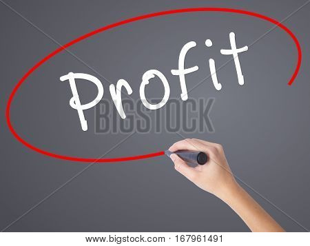 Woman Hand Writing Profit With Black Marker On Visual Screen