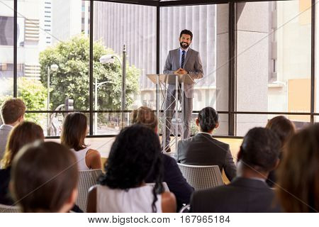 Hispanic man presenting business seminar smiling to audience
