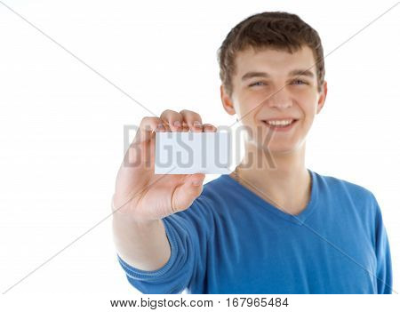 Young man with displaying blank business card. Isolated on white background.