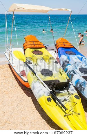 Water kayaks and pedal boats on the sea and on the beach