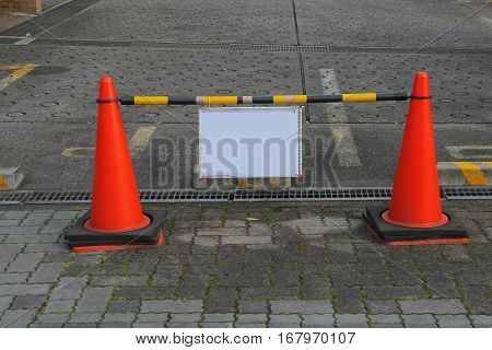 sign board with red cones on road