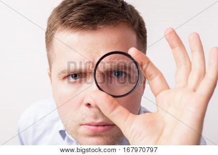 Man Holding Uv Ring For Photo Lens
