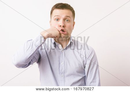 Young Man Hits His Fist In The Face. Punishing Yourself For Mistakes