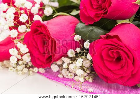 Closeup Of Red Roses Bouquet With White Flowers