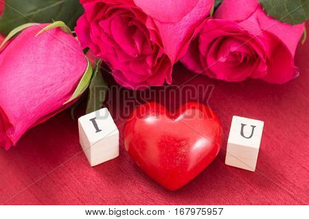 Red Heart And Roses, And Wooden Cubes With Letters I And U. I Love You Concept.