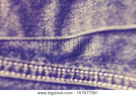 Vintage Toned Blurred Close Up Picture Of Jeans Fabric With Stitches.
