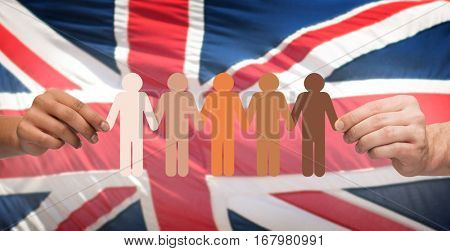 community, unity, population, race and humanity concept - multiracial couple hands holding chain of paper people pictogram over english flag background