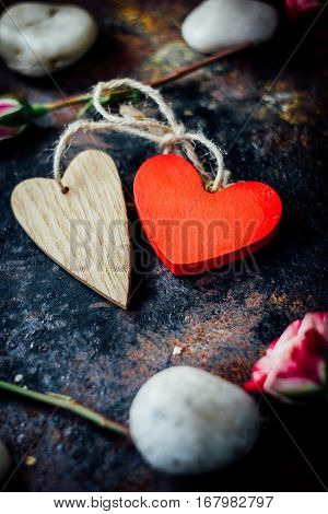 Two bounded hearts on black rustic background
