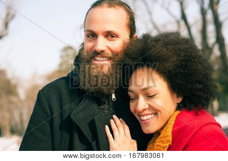 Romantic Multiethnic Couple In Love Hugging On The Street