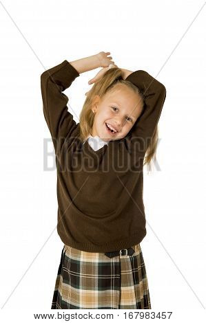 young beautiful happy schoolgirl in pigtails and uniform smiling happy and excited having fun isolated on white background in school girl education success and self confidence
