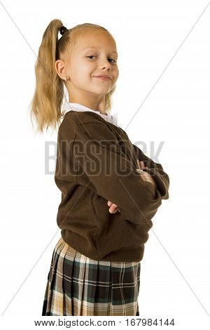 young beautiful happy schoolgirl in pigtails and uniform smiling happy posing proud isolated on white background in school girl education success and self confidence