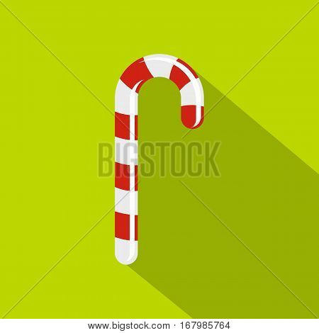 Striped candy cane icon. Flat illustration of striped candy cane vector icon for web on lime background