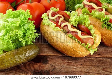 Hotdogs Ready-to-eat With Fresh Salad On Wooden Desk